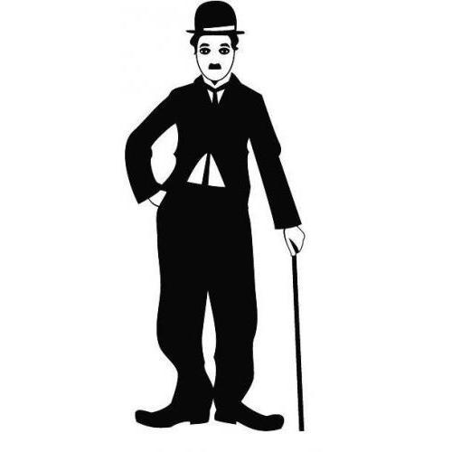 Charlie Chaplin standing